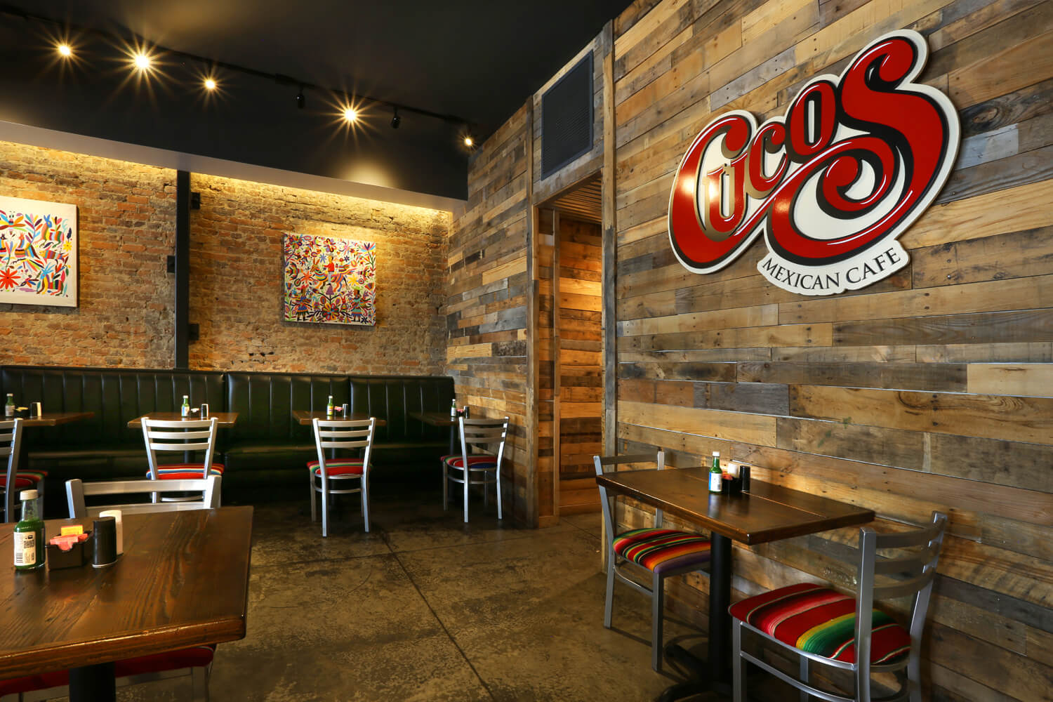 Cuco's Mexican Café Restaurant Designed by Foshee Architecture – Interior Sign on Pallet Wood Wall