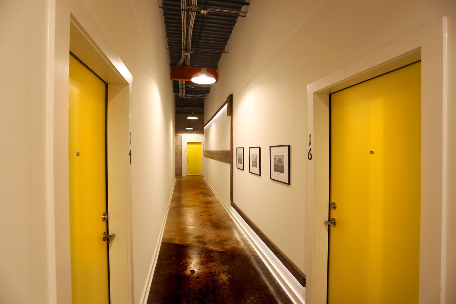 District 36 Lofts Designed by Foshee Architecture - View of Interior Hallway for Apartments