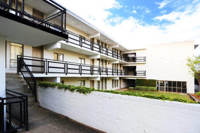 Perry Street Flats Designed by Foshee Architecture - View of the Exterior Overlooking the Courtyard