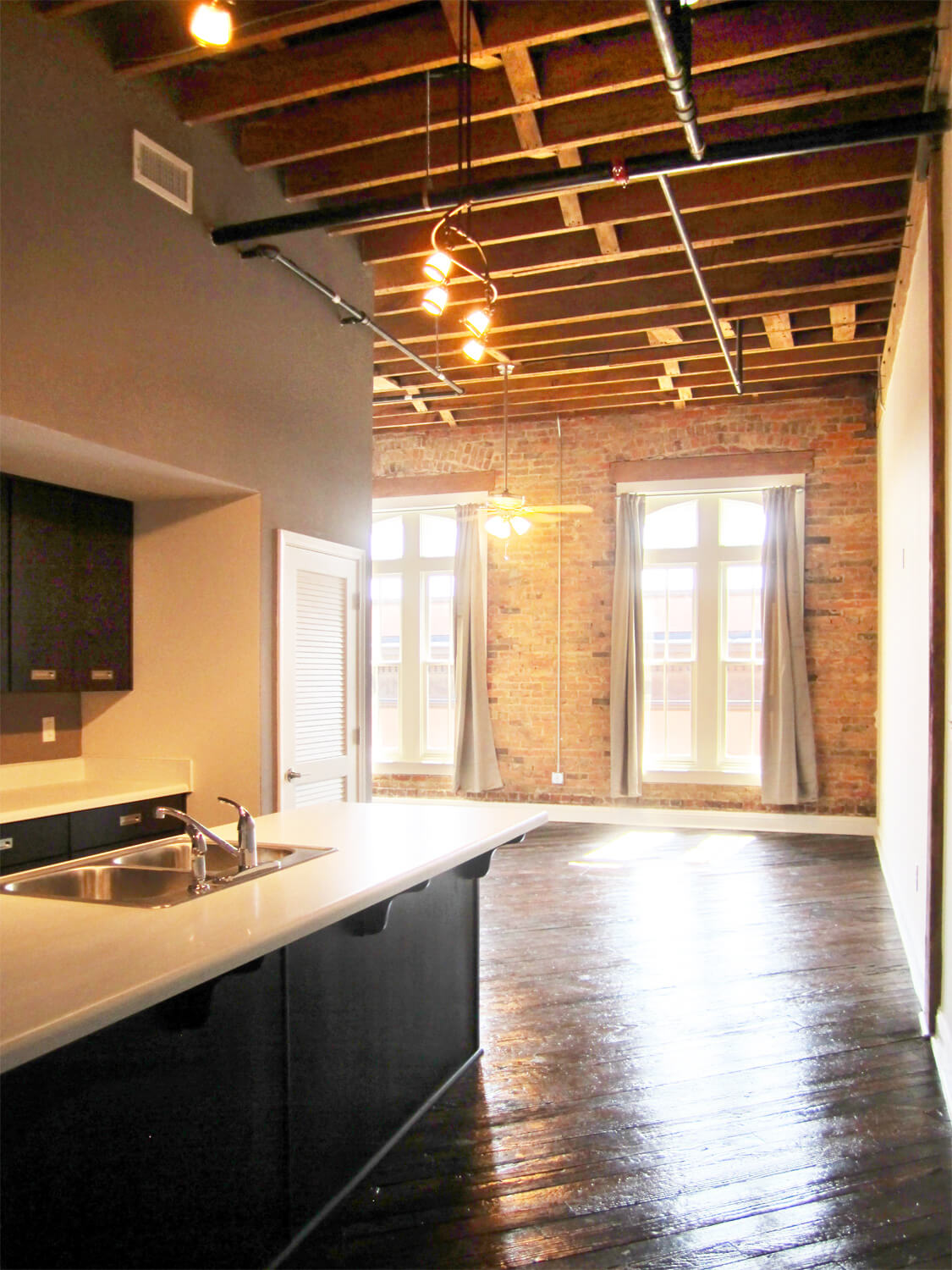 Printing Press Lofts Designed by Foshee Architecture - Interior View of Apartment with an Exposed Wood Ceiling