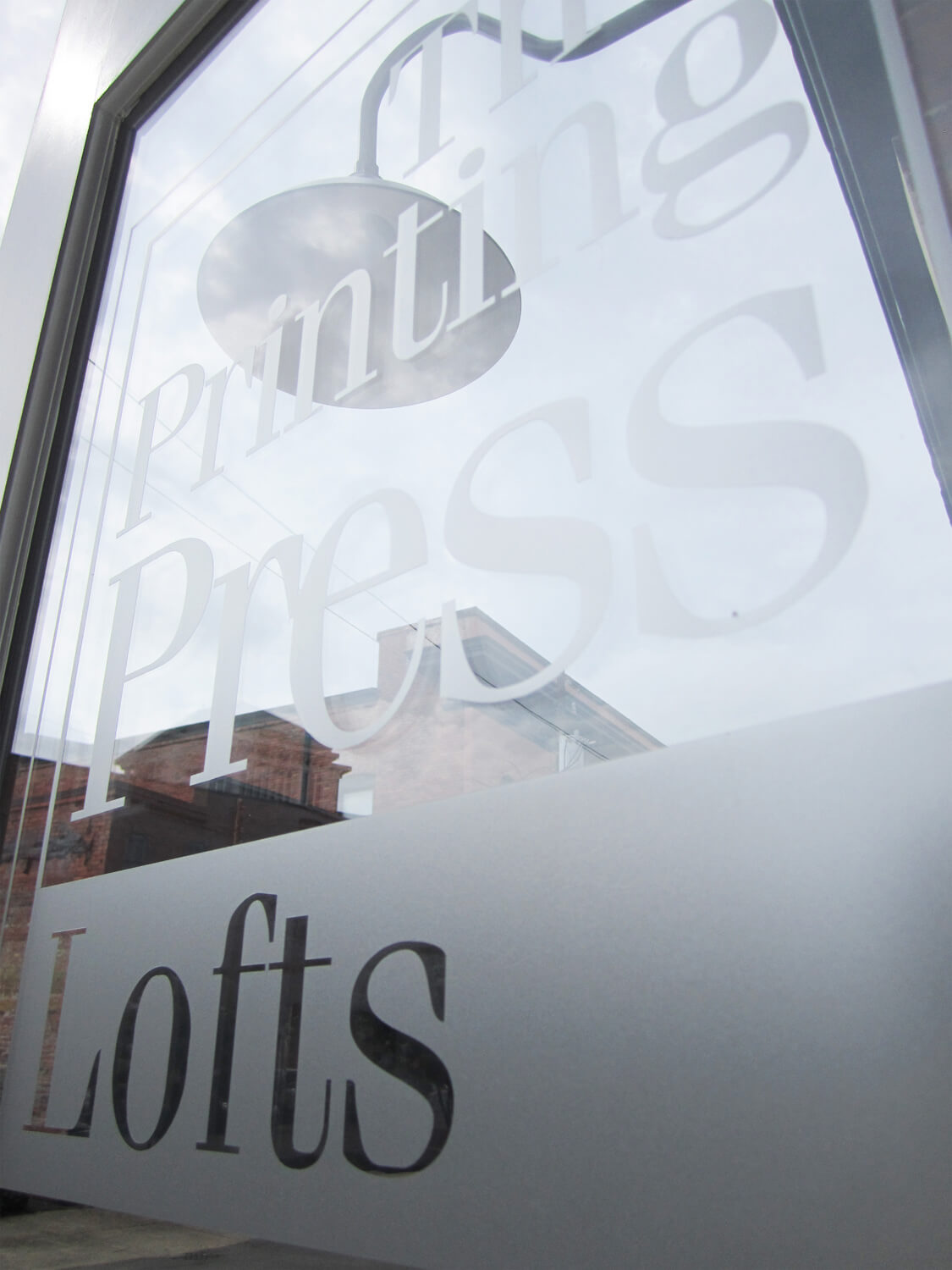 Printing Press Lofts Designed by Foshee Architecture - Sign on Front Door