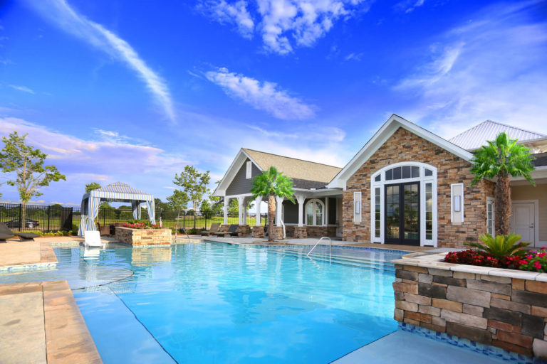 The Morgan Apartments Clubhouse Designed by Foshee Architecture - View of Pool Looking Towards the Clubhouse