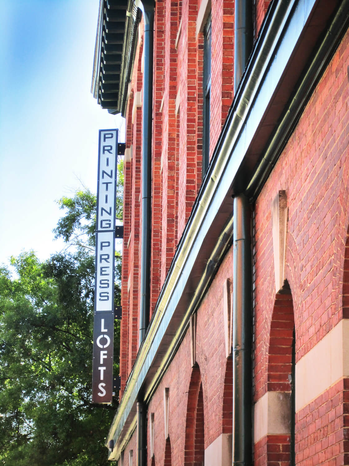 Printing Press Lofts Designed by Foshee Architecture – Exterior Blade Sign