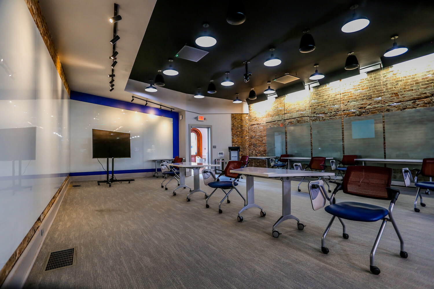 MGMWerx Collaboration Space - Classroom with Display Boards - Designed by Foshee Architecture