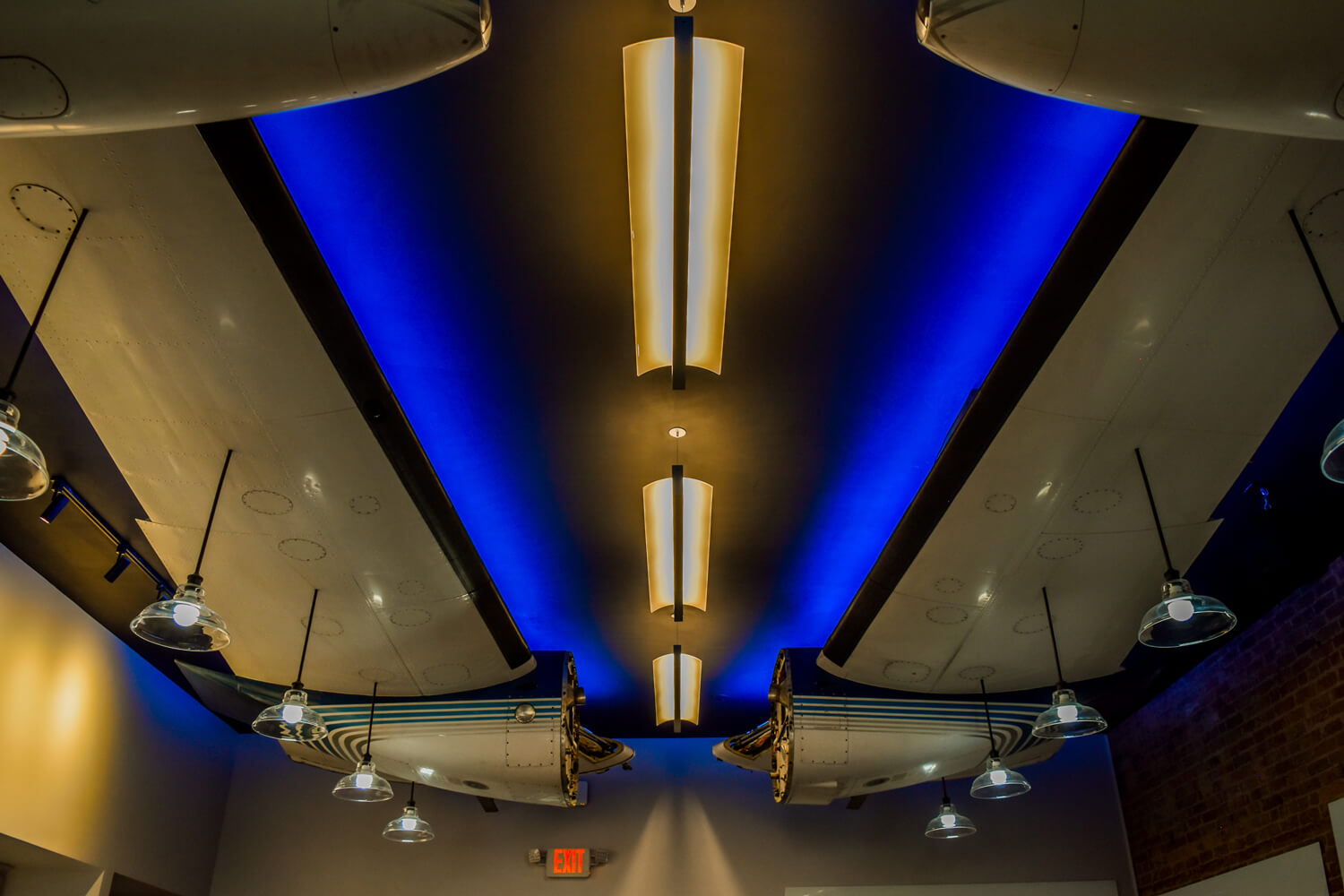 MGMWerx Collaboration Space - Airplane Wing Lighting - Designed by Foshee Architecture